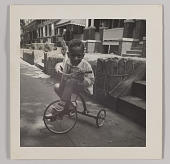 view Photographic print of Charles H. Houston, Jr. as a child on tricycle digital asset number 1