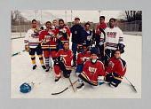 view Color photograph of Ice Hockey in Harlem team with their coach digital asset number 1
