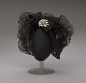 view Black cap with netted lace and silver flower brooch from Mae's Millinery Shop digital asset number 1
