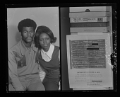view Studio Portrait of a Couple Sitting and Copy Work of a Document, Diptych digital asset number 1
