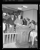view Indoor Photo of a Church Service, Man Speaking at a Podium digital asset number 1