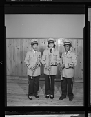view Indoor Portrait of Three Marching Band Members, Coleman High School digital asset number 1