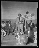 view Indoor Photo of a Man Speaking at a Microphone, Rev. H.H. Humes digital asset number 1