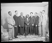 view Indoor group shot of Dr. Noble R. Frisby with unidentified men digital asset number 1
