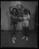 view Studio Portrait of Two Girls Standing Holding a Basketball digital asset number 1