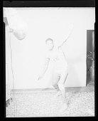 view Studio Portrait of Boy Standing Wearing a Basketball Uniform digital asset number 1