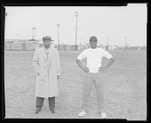 view Outdoor Photo of Two Men Standing on a Football Field digital asset number 1