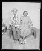 view Studio Portrait of a Mother and Father With Child digital asset number 1