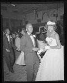 view Indoor portrait of young couple at Coleman High School prom digital asset number 1
