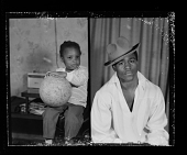 view Studio Portrait of a Man Sitting, Indoor Portrait of a Toddler Sitting, Diptych digital asset number 1