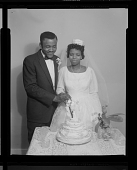 view Wedding Portrait of the Bride & Groom Cutting the Wedding Cake digital asset number 1