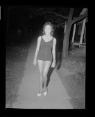 view Night Time Outdoor Photo of a Woman Standing Wearing a Bathing Suit digital asset number 1