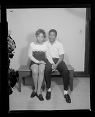view Studio Portrait of a Couple Sitting and Holding Hands digital asset number 1