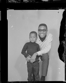 view Studio Portrait of a Father and Child Standing digital asset number 1
