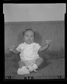 view Studio Portrait of an Infant Boy Sitting on a Sofa digital asset number 1