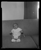 view Studio Portrait of an Infant Sitting on a Sofa digital asset number 1