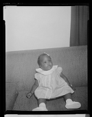 view Studio Portrait of a Toddler Girl Sitting on a Sofa digital asset number 1