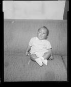 view Studio Portrait of a Toddler Boy Sitting on a Sofa digital asset number 1