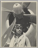 view Photograph of Tuskegee Airman Major Lee Rayford in front of a P-47 Thunderbolt digital asset number 1