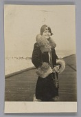 view Photo of a woman standing on boardwalk digital asset number 1