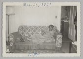 view Photographic print of a woman, Dittie, on a couch with a cigarette digital asset number 1