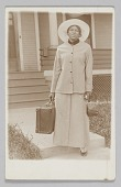 view Photographic postcard of unidentified woman holding a travel bag digital asset number 1