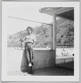 view Photographic print of an unidentified woman posed in front of a pool digital asset number 1