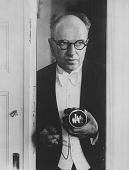 view Salomon with Ermanox Camera in Doorway digital asset: Gelatin silver print by Erich Salomon, Salomon with Ermanox camera