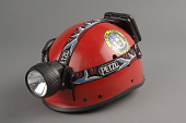 view Police Seach Helmet digital asset: Helmet with lamp, used during the September 11, 2001 rescue and recovery operation at the World Trade Center site.
