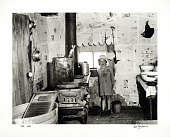view Photographic History Collection: Carl Mydans digital asset: Little girl standing in sharecropper's shack in Missouri