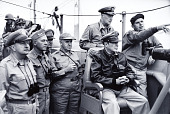 view General Douglas MacArthur with Army, Marine, Navy, and Air Force commanders, Inchon, Korea digital asset: General MacArthur watches landing at Inchon, Korea with Army, Marine, Navy and Air Force commanders