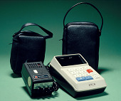 view Sharp EL-8 Electronic Calculator digital asset: Sharp EL-8 Desktop Electronic Calculator and Adapter, Front View with Cases