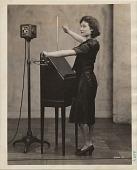 view [Alexandra Stepanoff playing RCA theremin, black & white photoprint] digital asset: [Alexandra Stepanoff playing RCA theremin, black & white photoprint]