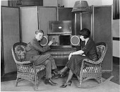 view [Young man and woman listening to the radio, black-and-white photoprints.] digital asset: [Young man and woman listening to the radio, black-and-white photoprints.]