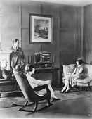 view [Two couples listening to a radio, black-and-white photoprint.] digital asset: [Two couples listening to a radio, black-and-white photoprint.]