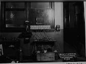 view Landline switchboard, Belmar, [New Jersey], Radio Corporation of America, Engineering Department, [black-and-white photoprint.] digital asset: Landline switchboard, Belmar, [New Jersey], Radio Corporation of America, Engineering Department, [black-and-white photoprint.]