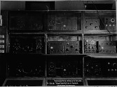 view Receiving sets on shelves, Belmar, [New Jersey], Radio Corporation of America, Engineering Department, [black-and-white photoprint.] digital asset: Receiving sets on shelves, Belmar, [New Jersey], Radio Corporation of America, Engineering Department, [black-and-white photoprint.]