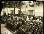 view [Condenser bank in the Marconi Wireless Telegraph Company of America H.P. Station in Marion, Massachusetts, black-and-white photoprint.] digital asset: [Condenser bank in the Marconi Wireless Telegraph Company of America H.P. Station in Marion, Massachusetts, black-and-white photoprint.]