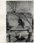 view [Tomb of the Unknown Revolutionary War Soldier with eternal flame in Washington Square] [black & white photoprint] digital asset: [Tomb of the Unknown Revolutionary War Soldier with eternal flame in Washington Square] [black & white photoprint].