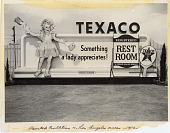 view [Billboard with cutout of young girl advertising Texaco restrooms : black and white photoprint] digital asset: [Billboard with cutout of young girl advertising Texaco restrooms : black and white photoprint], 1953.