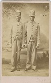 view [Two African American men wearing top hats with advertising for Higgins German Laundry Soap [black and white photoprint.] digital asset: [Two African American men wearing top hats with advertising for Higgins German Laundry Soap [black and white photoprint.]