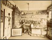 view [William Hammer sitting in his lab, black & white photoprint] digital asset: [William Hammer sitting in his lab, black & white photoprint]
