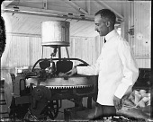 view [George Elicas Doumar using waffle cone making machine: black-and-white glass plate negative.] digital asset: [George Elicas Doumar using waffle cone making machine: black-and-white glass plate negative.]