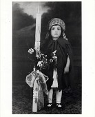 view [Girl holding a tall decorated candle on Palm Sunday: b&w photoprint.] digital asset: [Girl holding a tall decorated candle on Palm Sunday: b&w photoprint.]