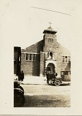 view [Church exterior with small groups of people and cars in front: b&w photoprint] digital asset: [Church exterior with small groups of people and cars in front: b&w photoprint]
