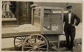 view [Man peddling popcorn or hot roasted peanuts from a street cart: b&w photoprint] digital asset: [Man peddling popcorn or hot roasted peanuts from a street cart: b&w photoprint]