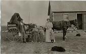 view [Peddler Ferris. S. Skaff selling Watkins remedies to North Dakota homesteaders from a horse drawn wagon: b&w photoprint postcard] digital asset: [Peddler Ferris. S. Skaff selling Watkins remedies to North Dakota homesteaders from a horse drawn wagon: b&w photoprint postcard]