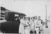 view [Six young women and a young man siting in or standing next to an automobile parked on the street: b&w photoprint] digital asset: [Six young women and a young man siting in or standing next to an automobile parked on the street: b&w photoprint]