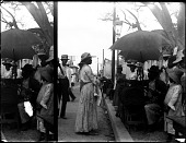 view Buying tobacco by the yard in Jamaica. [Active No. 7609 : stereo photonegative, cropped.] digital asset: Buying tobacco by the yard in Jamaica. [Active No. 7609 : stereo photonegative, cropped.]