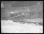 view Mansfield, Mass.: Four persons were injured, one fatally, when the Owl, a crack Boston-New York train of the New York, New Haven and Hartford railroad crashed into a freight train at a cross-over here last night. Photo shows the wrecked engine of the O... digital asset: Mansfield, Mass.: Four persons were injured, one fatally, when the Owl, a crack Boston-New York train of the New York, New Haven and Hartford railroad crashed into a freight train at a cross-over here last night. Photo shows the wrecked engine of the Owl. 5/24/26. [Active no. 1917 : non-stereo photonegative,] 1926.